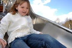 Fille heureuse sur la glissière Images stock