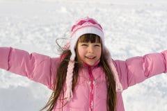 Fille heureuse sur la neige Photo stock