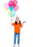 Fille heureuse tenant les ballons colorés Photographie stock