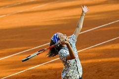 Fille jouant au tennis Photo stock