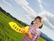 fille jouant avec une bille Image stock