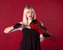 Fille jouant la verticale de violon Photos libres de droits