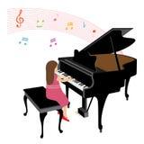Fille jouant le piano à queue Photographie stock libre de droits