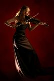 Fille jouant le violon Photo stock