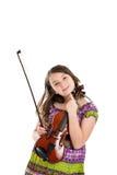 Fille jugeant la verticale de violon d'isolement sur le blanc Photographie stock