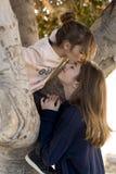 Fille lui donnant un baiser Image stock