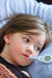 Fille malade avec la fièvre Photos libres de droits