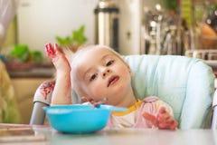 Fille mangeant de la confiture Photos libres de droits