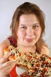 Fille mangeant de la pizza photo libre de droits