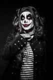 Fille mauvaise effrayante de clown Images stock