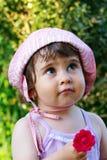 Fille mignonne avec la fleur Photos libres de droits