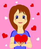 Fille mignonne avec le coeur dans des ses mains d'isolement sur le fond rose photographie stock