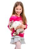 Fille mignonne avec le lapin de bébé Photographie stock libre de droits