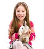 Fille mignonne avec le lapin de bébé Photographie stock
