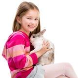Fille mignonne avec le lapin de bébé Photos stock