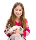 Fille mignonne avec le lapin de bébé Images stock
