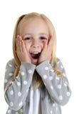 Fille mignonne avec une expression choquée ou étonnée ses mains il Photographie stock libre de droits