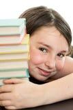 Fille mignonne d'école avec la pile de livres Image libre de droits