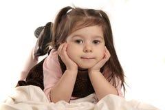 Fille mignonne sur le blanc Image stock