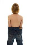 Fille mince dans de grands jeans de taille Photos libres de droits