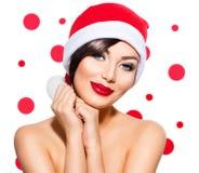 Fille modèle de beauté dans le chapeau de Santa Image libre de droits