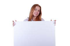 Fille montrant le carton Photos libres de droits