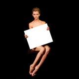 Fille nue tenant une affiche Images libres de droits