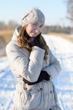 Fille pendant l'hiver. Photos stock