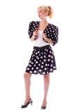 Fille Pin-vers le haut dans le procès de point de polka Image stock