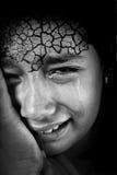 Fille pleurante avec criqué Photographie stock