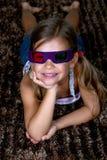 Fille portant les lunettes 3D Photo libre de droits