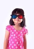 Fille portant les lunettes 3D Photographie stock