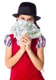 Fille rêvante avec l'argent dans des mains Photos stock
