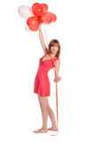 Fille Red-haired dans une robe rose avec des ballons Photos stock