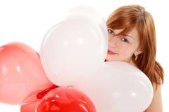 Fille Red-haired dans une robe rose avec des ballons Images libres de droits