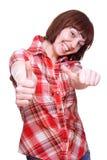 fille renonçant aux pouces riants de chemise Images stock