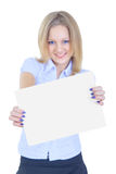 Fille retenant une feuille de papier blanche Photographie stock
