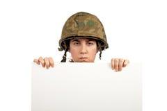Fille sérieuse de soldat Photographie stock libre de droits