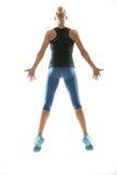 Fille sautante dans les vêtements de sport Image stock