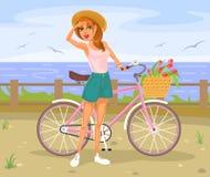 Fille se tenant à côté d'une bicyclette Images libres de droits