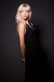 Fille sensuelle dans la robe noire Images libres de droits