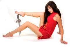 Fille sexuelle avec l'épée Photographie stock