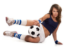 Fille sexy avec la bille de football Photos stock