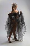 Fille sexy dans la robe diaphane Photo stock