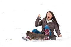 Fille sledging Photographie stock libre de droits
