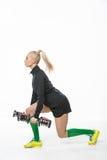 Fille sportive avec des haltères Photographie stock libre de droits