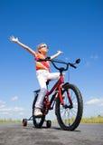 Fille sur la bicyclette Image stock