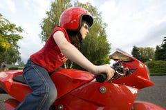 Fille sur la moto Photo libre de droits