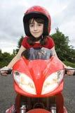 Fille sur la moto Photos libres de droits