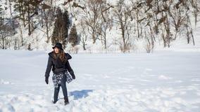 Fille sur la neige Photographie stock